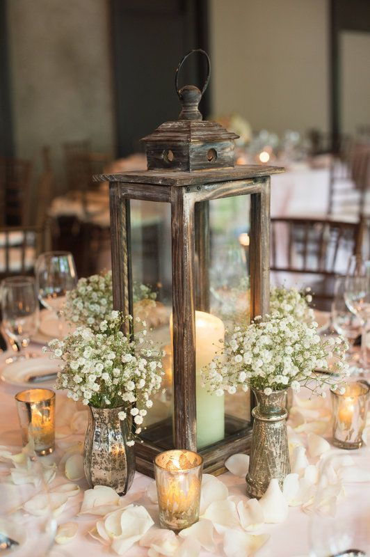 The main idea for a barn wedding centerpiece is to take as many natural materials as you can to dip everybody into the cozy and calm rustic atmosphere. Any mason jars or vases covered with lace and burlap with flowers and greenery will make a fantastic centerpiece.