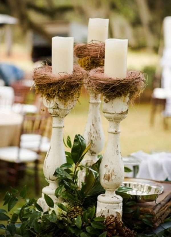 For a garden wedding with a rustic feel, display large, colorful bird cages on tables for a simple, yet eye-catching, centerpiece. Weave ivy or a few flowers into the cage if you choose, or set a few candles inside to create a more intimate mood. Birdcage created by Emily Herzig Floral Studio; Photo by .