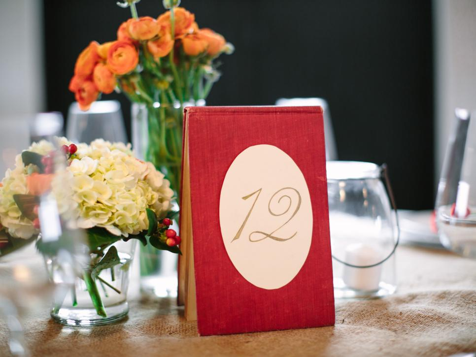 Red Vest Entertainment Table Number Ideas